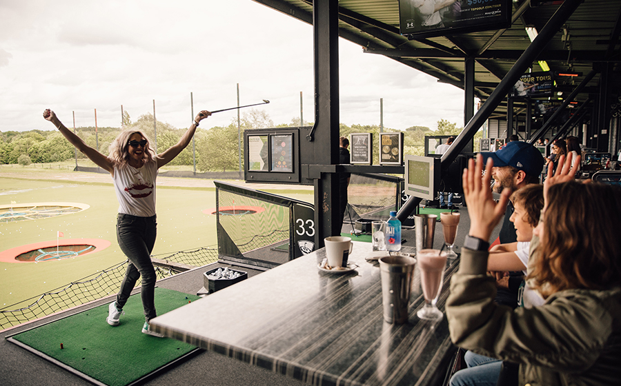 Mum celebrating Topgolf shot with family
