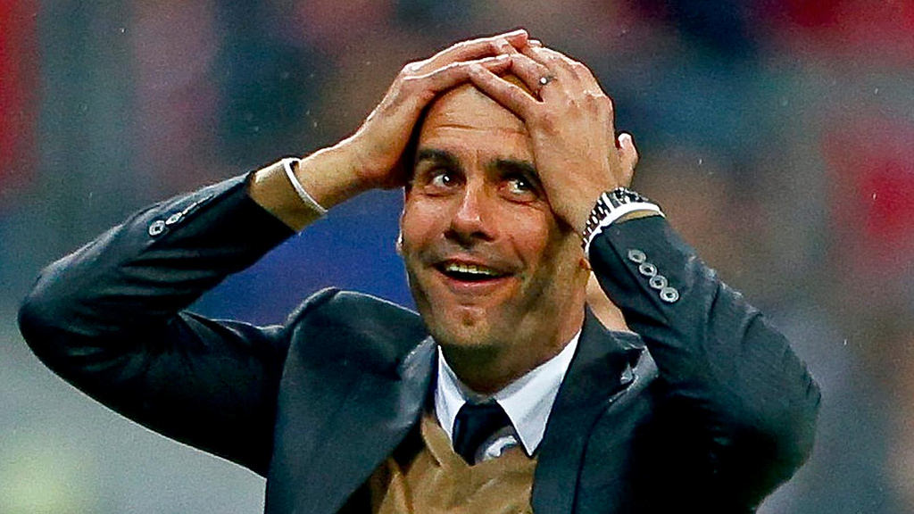 Pep Guardiola with his hands on his head