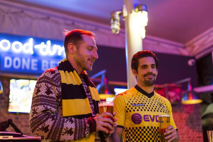 football fans at Topgolf